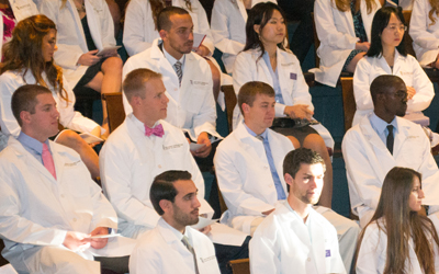School of Dentistry first-year students donned their white coats for the first time in historic Davidge Hall.