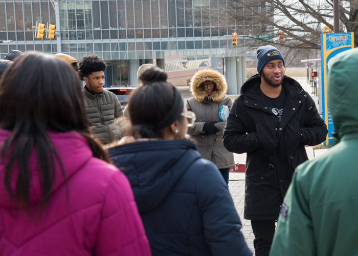 Marcus Edwards, a CSU admissions counselor and CSU alumnus, took the CURE scholars on a private tour of Coppin State University.