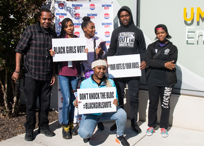 Students from Augusta Fells Savage Institute of Visual Arts cast their ballots as first-time voters, after members of Black Girls Vote helped shuttle them over to the UMB Community Engagement Center voting site from their high school.