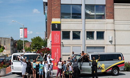 Two 15-passenger vans have been donated to the University of Maryland, Baltimore Police Athletic/Activities League program by MileOne Autogroup.