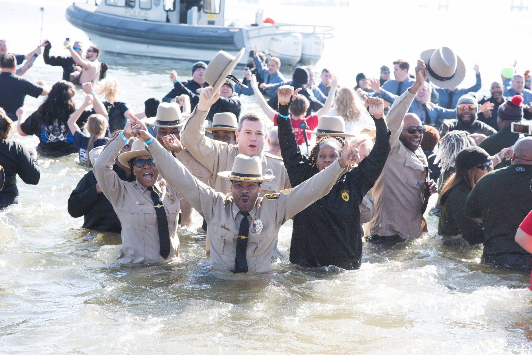 UMB police officers dive headfirst into the frigid waters of the Chesapeake Bay to raise money for the Maryland Special Olympics at the 2018 Polar Bear Plunge.
