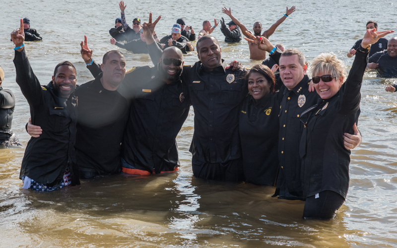 From left: Lt. Matthew Johnson, Lt. Todd Ring, Pfc. Joseph Fair, Pfc. Edouardo Edouazin, police dispatcher Erika Malone, Lt. Thomas Leone, and Chief Alice Cary strike a pose after plunging into the freezing Chesapeake Bay for the annual Polar Bear Plunge.