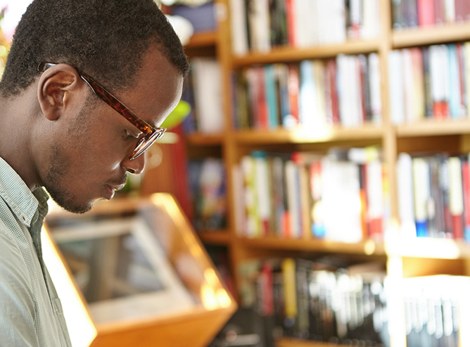 Man reading book at bookstore