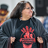 Indigenous women wearing a t-shirt that says Indigenous strong
