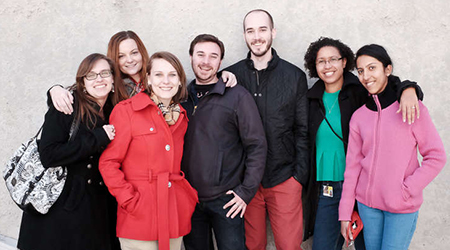 Students from the University of Maryland Graduate School gather and smile for the camera.