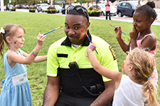 Lt. Johnson having his face painted by children